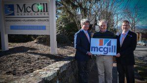 Joel Storrow, Keith Webb, and Andy Lovingood with new McGill logo