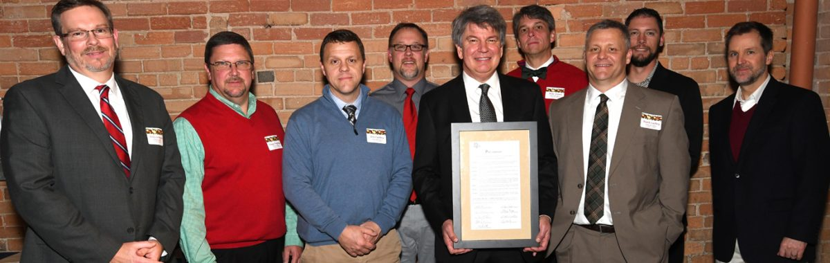 McGill Board of Directors Presents Proclamation to Joel Storrow