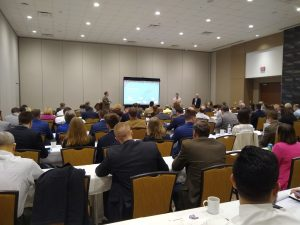 """Conference attendees listen to, """"Game Changer! Turning Spaces into Great Places in your Community"""" during the NCCCMA Winter Seminar on February 6th."""