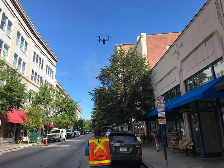 McGill Surveyor with drone on Haywood Street
